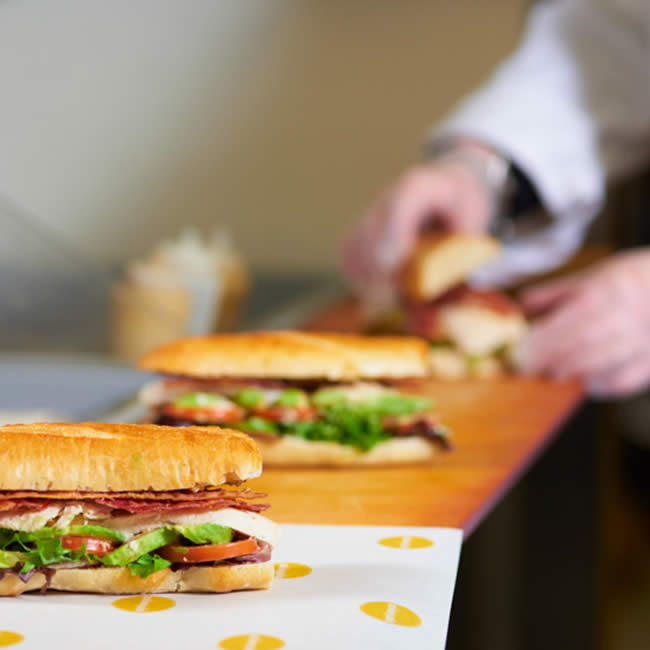 Photograph of sandwiches being made